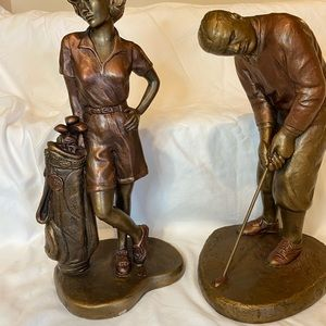 Decorative make and female golf statues